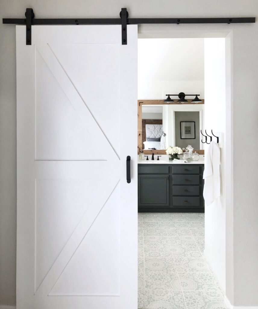DIY Bathroom barn door tutorial featured by top DIY blog, Domestic Blonde: finished barn door