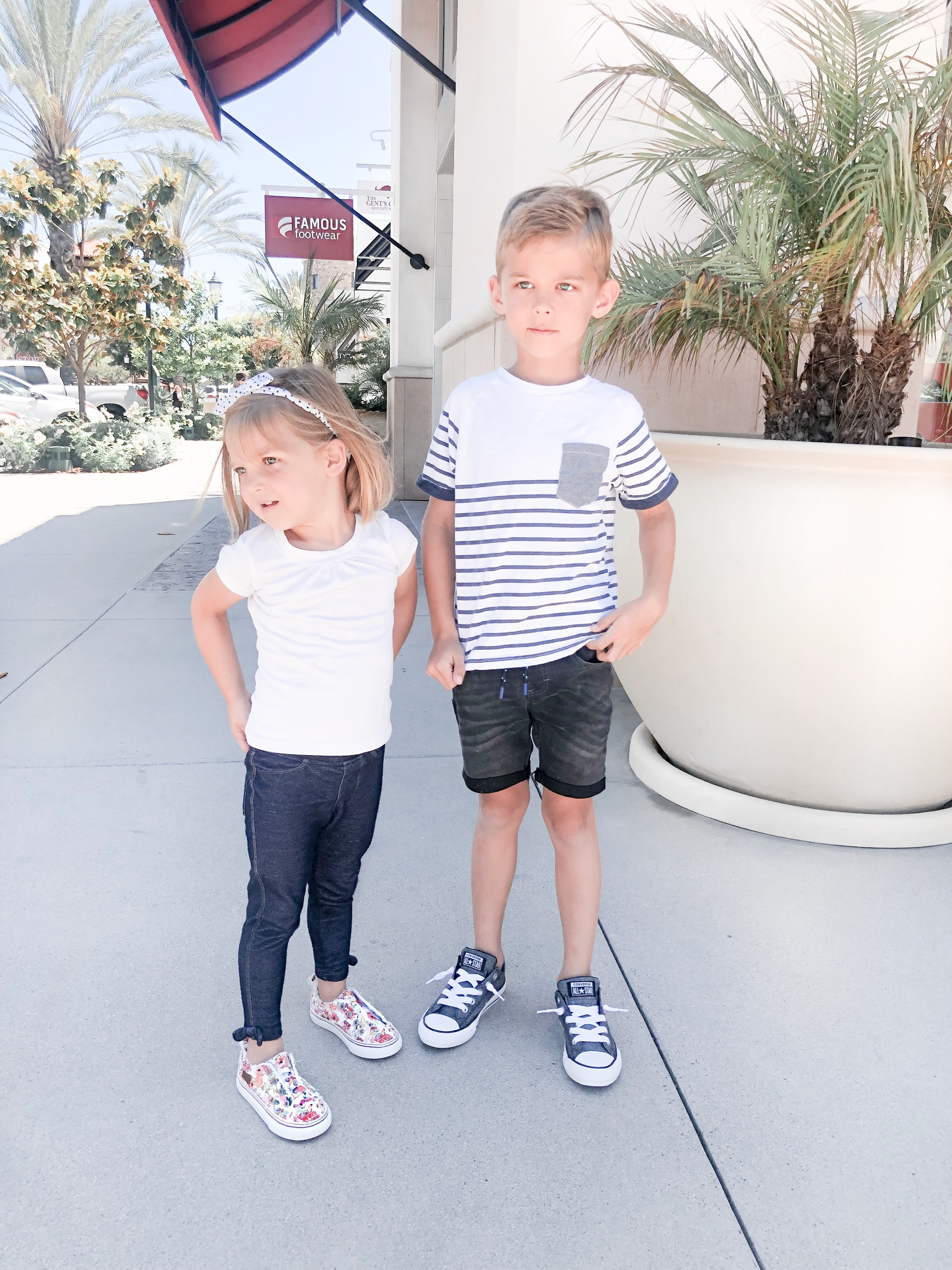 Back To School Shoes from Famous Footwear by popular San Diego fashion blog, Domestic Blonde: image of a little boy and girl standing outside of a famous footwear and wearing their new shoes.