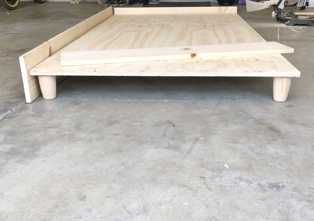 DIY Twin Platform Bed Frame tutorial featured by top US DIY blog, Domestic Blonde.