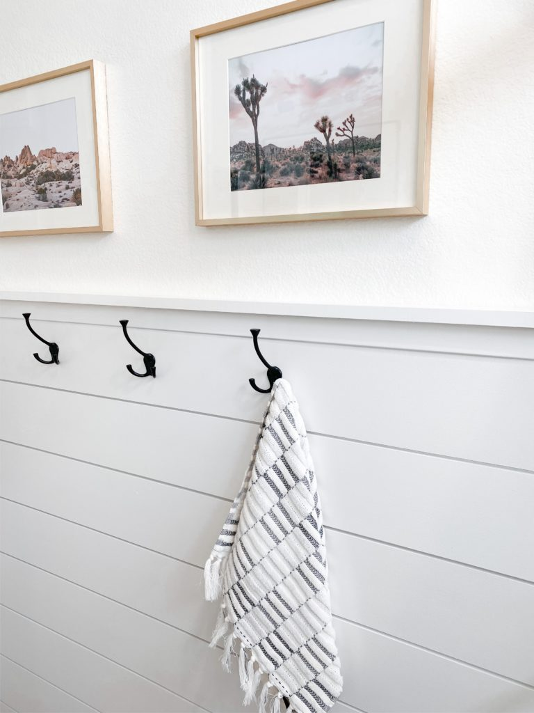 Small Bathroom Remodel Ideas with before and after pictures featured by top US DIY blog, Domestic Blonde: shiplap wall and art in bathroom
