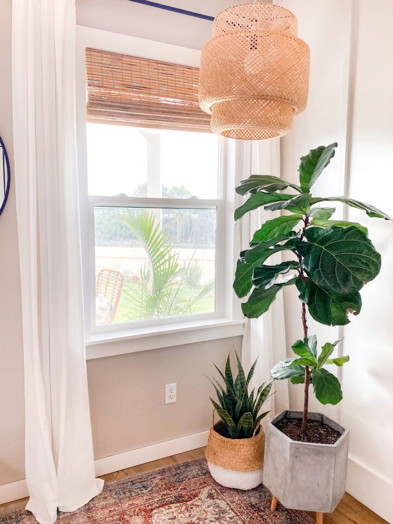 DIY Window Frame by popular San Diego DIY blog, Domestic Blonde: image of framed window in a living room.