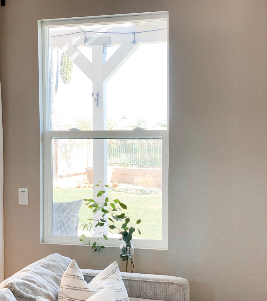 DIY Window Frame by popular San Diego DIY blog, Domestic Blonde: image of a window in a living room.