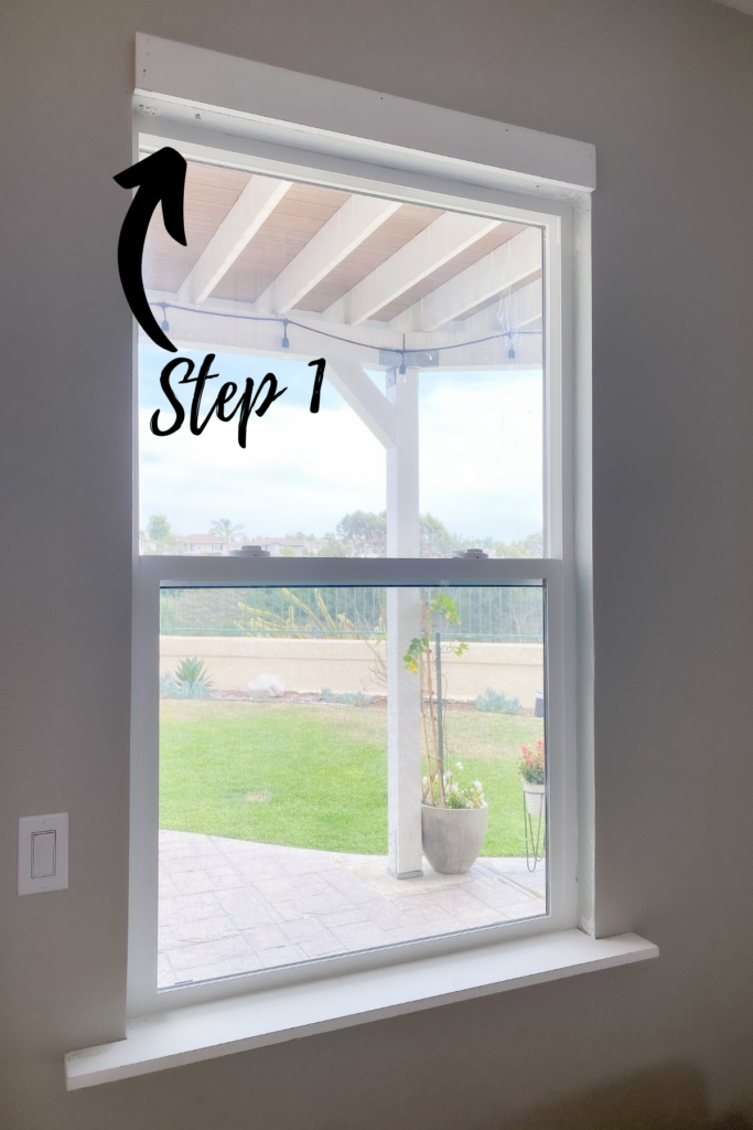 DIY Window Frame by popular San Diego DIY blog, Domestic Blonde: image of a window being framed in a living room.