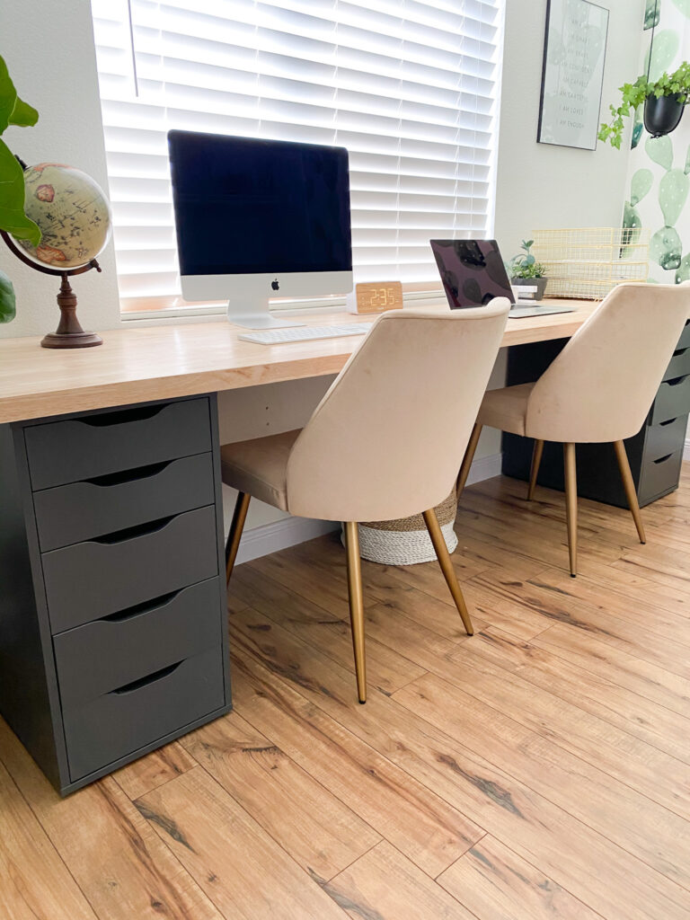 DIY Home Office Desk by popular San Diego DIY blog, Domestic Blonde: image of a home office desk, fabrick chairs, Mac laptop, Mac Desktop, and gold wire baskets.